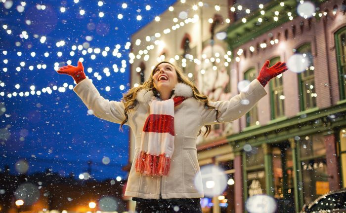 girl enjoying christmas lights